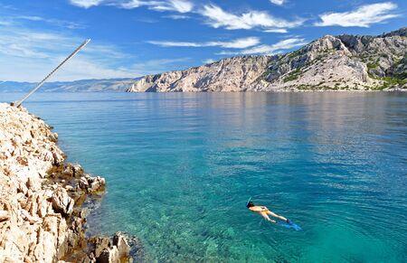 Woman snorkeling photo