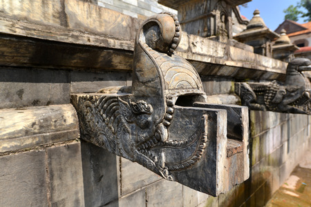 carved stone: Carved stone public fountain in Pashupatinath, Nepal