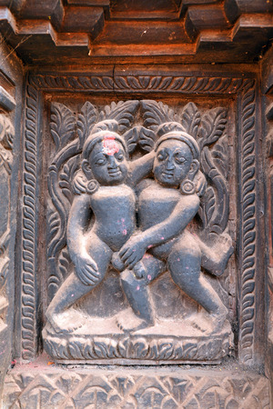Erotic wooden carving motif on a Hindu temple in Nepal Stock Photo