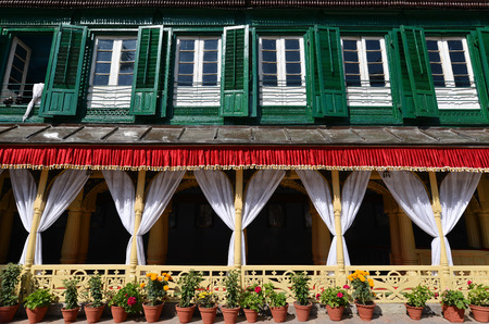 king palace: King palace with green shutters and flower pots. Durbar square, Kathmandu, Nepal Editorial