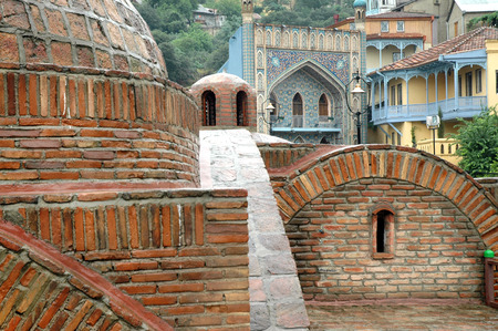 in copula: Architecture of the Old Town of Tbilisi, Georgia, in Abanotubani area. Domes of sulfur baths, Jumah mosque and carved balconies