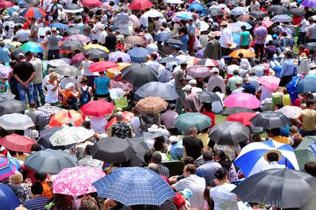 pentecost: CSIKSOMLYO, ROMANIA - JUNE 7: Crowds of Hungarian pilgrims gather to celebrate the Pentecost and the catholic pilgrimage on June 7, 2014 in Sumuleu Ciuc (Csiksomlyo), Romania