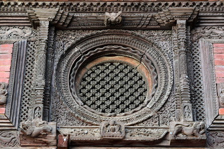 25 29 years: KATHMANDU  SEPTEMBER 29: Hundred years old wooden carvings in the Durbar square now destroyed after the massive earthquake that hit Nepal on April 25 2015. On September 29 2013 in Kathmandu Nepal