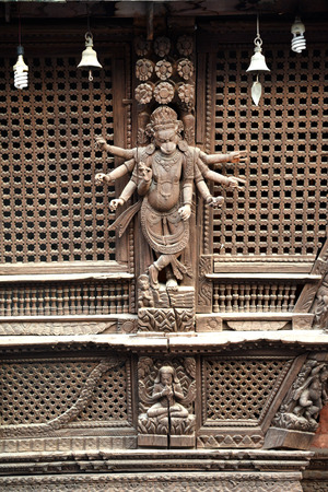 25 29: KATHMANDU  SEPTEMBER 29: Wooden carvings on a Hindu temple now destroyed after the massive earthquake that hit Nepal on April 25 2015. On September 29 2013 in Kathmandu Nepal