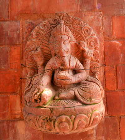 PASHUPATINATH  OCTOBER 10: Ancient stone Hindu god statue now damaged after the earthquake that hit Nepal on April 25 2015. On October 10 2013 in Pashupatinath Nepal