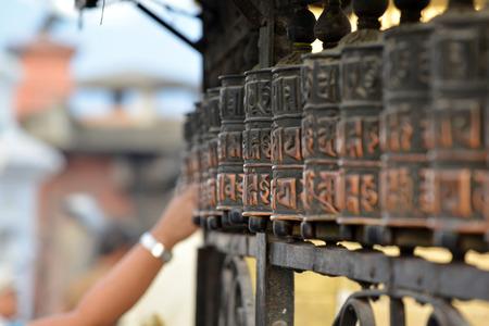 remained: SWAYAMBHUNATH  SEPTEMBER 29: Prayer wheels of Swayambhunath remained intact after the massive earthquake that hit Nepal on April 25 2015. On September 29 2013 in Swayambhunath Nepal