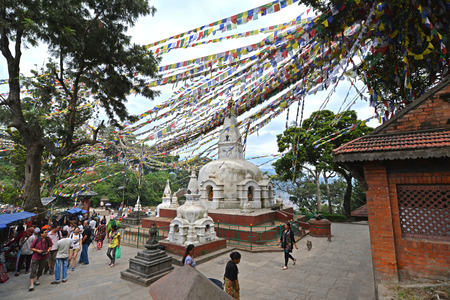 collapsed: SWAYAMBHUNATH  SEPTEMBER 29: Buddhist stupa with prayer flags now collapsed after the massive earthquake that hit Nepal on April 25 2015. On September 29 2013 in Swayambhunath Nepal