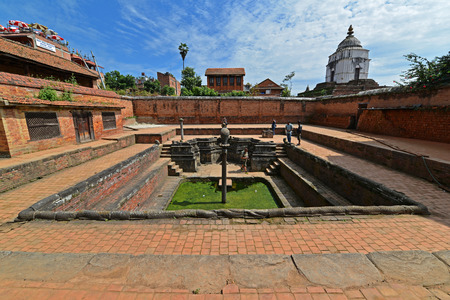 waterspout: BHAKTAPUR  OCTOBER 10: Ancient fountain in the Unesco heritage site of Bhaktapur now destroyed by the earthquake that hit Nepal on April 25 2015. On Oct. 10 2013 in Bhaktapur Nepal