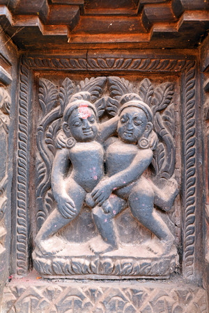 KATHMANDU  OCTOBER 10: Erotic wooden carving detail in Bhaktapur. It was destroyed after that earthquake hit Nepal on April 25 2015. On October 10 2013 in Kathmandu Nepal