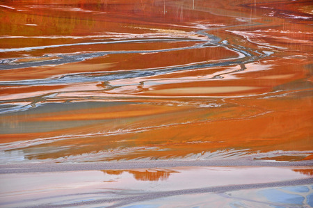 gold mine: Pollution of a lake with contaminated water from a gold mine