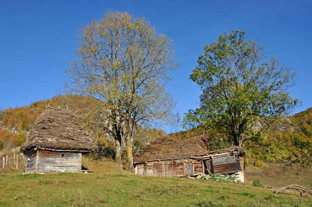 Small abandoned ranch in the mountains photo