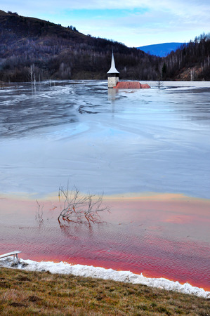 inundated: Abandoned church flooded by a lake full with chemical residuals. Geamana, Rosia Montana