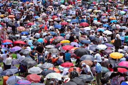 pentecost: CSIKSOMLYO ROMANIA  JUNE 7: Crowds of Hungarian pilgrims praying during the Pentecost and the catholic pilgrimage on June 7 2014 in Sumuleu Ciuc Csiksomlyo Romania