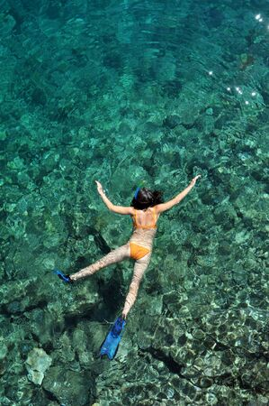 bonaire: Young woman snorkeling in Bonaire Caribbean