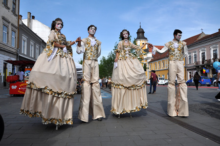cluj: CLUJ NAPOCA  MAY 24: Theater group called Famous for Entertainment performing street theater on stilts in medieval costumes inside the Man.In.Fest during the Cluj Days of Cluj. On May 24 2015 in in Cluj Romania