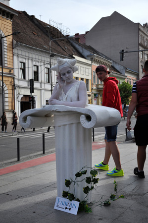 napoca: CLUJ NAPOCA  MAY 24: Living statue woman street performer doing a busking mime inside the Man.In.Fest during the Cluj Days of Cluj. On May 24 2015 in in Cluj Romania