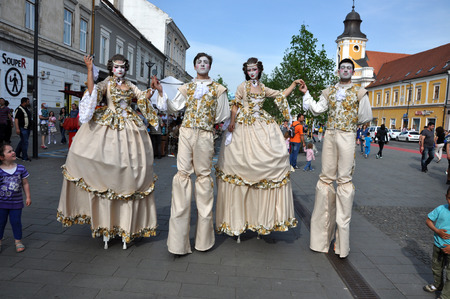 CLUJ NAPOCA  MAY 24: Theater group called Famous for Entertainment performing street theater on stilts in medieval costumes inside the Man.In.Fest during the Cluj Days of Cluj. On May 24 2015 in in Cluj Romania