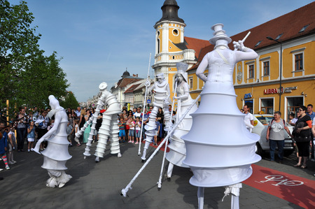 cluj: CLUJ NAPOCA  MAY 24: Parola Bianca theater group performing street theater on stilts inside the Man.In.Fest during the Cluj Days of Cluj. On May 24 2015 in in Cluj Romania Editorial