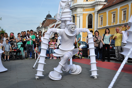 napoca: CLUJ NAPOCA  MAY 24: Parola Bianca theater group performing street theater on stilts inside the Man.In.Fest during the Cluj Days of Cluj. On May 24 2015 in in Cluj Romania Editorial