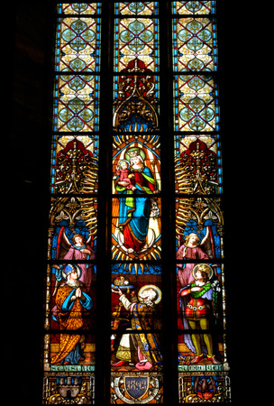 liturgical: CLUJ NAPOCA ROMANIA  DECEMBER 27: Biblical scene on a stained glass window inside the Gothic Roman Catholic Church of Saint Michael built in 1390. On december 27 2003 in Cluj Romania