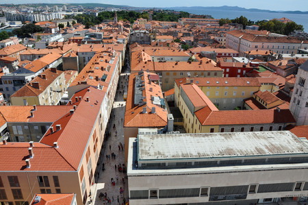 starigrad: ZADAR CROATIA  AUGUST 25: Unidentified tourists visiting the Stari Grad Old Town of the Unesco heritage city of Zadar. On 25 August 2014 in Zadar Croatia