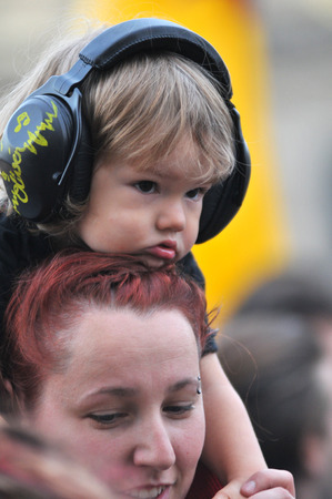 muff: BONTIDA - JUNE 26, 2015: A child wearing ear muff for kids during a concert at Electric Castle Festival at June 26, 2015 in the Banffy castle in Bontida, Romania Editorial