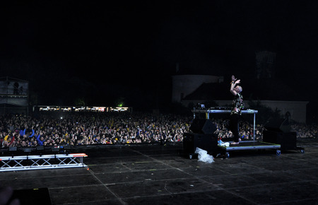 dubstep: BONTIDA - JUNE 26, 2015: Fatboy Slim aka Norman Cook performs live at the main stage of the Electric Castle Festival at June 26, 2015 in the Banffy castle in Bontida, Romania