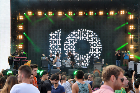 napoca: CLUJ NAPOCA, ROMANIA  AUGUST 2, 2015: Crowd of partying people enjoy a Irish Maffia live concert at the Untold Festival