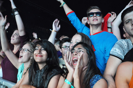 napoca: CLUJ NAPOCA, ROMANIA  JULY 30, 2015: Crowd of cheerful young people having fun during a live concert at Untold Festival in the European Youth Capital city of Cluj Napoca