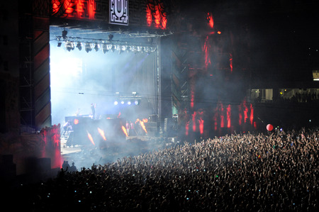 clubbers: CLUJ NAPOCA, ROMANIA  JULY 30, 2015: Crowd of partying people enjoy a Dimitri Vegas and Like Mike live concert at the Untold Festival in the European Youth Capital city of Cluj Napoca