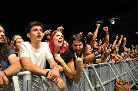 headbanging: CLUJ NAPOCA, ROMANIA  AUGUST 2, 2015: Headbanging crowd during a rock concert at the Untold Festival Editorial