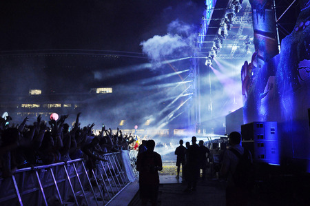 clubbers: CLUJ NAPOCA, ROMANIA  JULY 30, 2015: Dimitri Vegas and Like Mike performs a live concert at the Untold Festival in the European Youth Capital city of Cluj Napoca Editorial