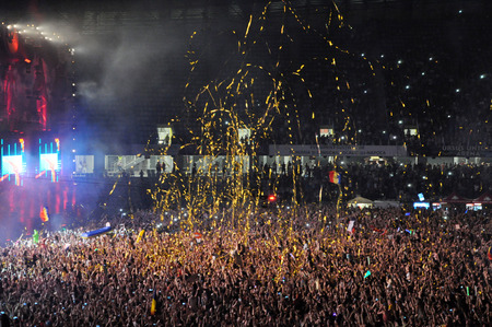 kolozsvar: CLUJ NAPOCA, ROMANIA  AUGUST 2, 2015: Crowd of  people watching a David Guetta concert at Untold Festival Editorial