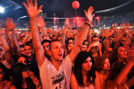 clubbers: CLUJ NAPOCA, ROMANIA  JULY 30, 2015: Crowd of cheerful young people having fun during a live concert at Untold Festival in the European Youth Capital city of Cluj Napoca
