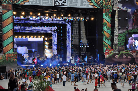 CLUJ NAPOCA, ROMANIA  AUGUST 2, 2015: Crowd of partying people enjoy a Irish Maffia live concert at the Untold Festival