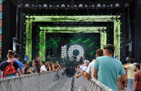 CLUJ NAPOCA, ROMANIA  AUGUST 2, 2015: Crowd of cheerful people having fun during an Irish Maffia concert at Untold Festival