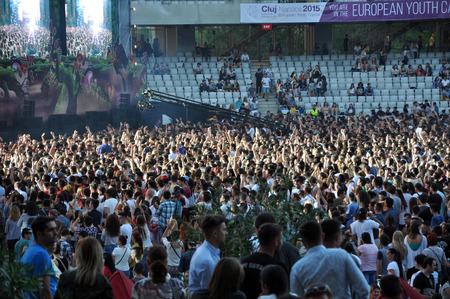 napoca: CLUJ NAPOCA, ROMANIA  JULY 30, 2015: Crowd of party people raising their hands during a Tom Odell live concert at the Untold Festival