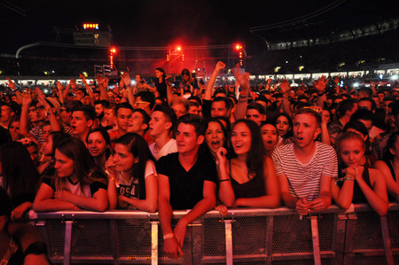 CLUJ NAPOCA, ROMANIA  JULY 30, 2015: Crowd of cheerful young people having fun during a live concert at Untold Festival in the European Youth Capital city of Cluj Napoca