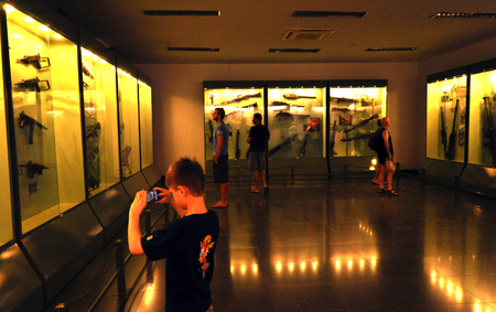 remnants: HO CHI MINH - MARCH 7: Tourists visiting the interior of the War Remnants Museum in Saigon. On March 7, 2013 in Ho Chi Minh, Vietnam