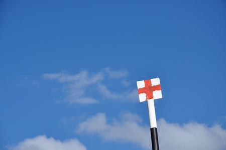 red cross: Trekking signpost in the mountains. Red cross on white background