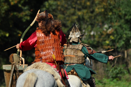 nomadic: CLUJ-NAPOCA, ROMANIA - OCTOBER 3: Members of Eagles of Calata Nomadic group performing a free equestrian demonstration with Hunnic and archaic Hungarian costumes. On October 3, 2015 in Cluj, Romania