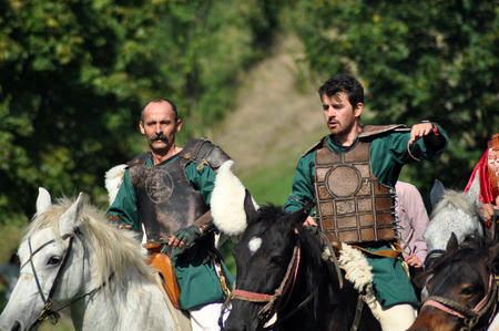 the archaic: CLUJ-NAPOCA, ROMANIA - OCTOBER 3: Members of Eagles of Calata Nomadic group performing a free equestrian demonstration with Hunnic and archaic Hungarian costumes. On October 3, 2015 in Cluj, Romania