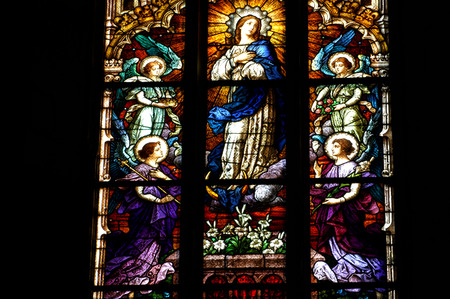 liturgical: CLUJ NAPOCA - DECEMBER 27: Biblical scene on a stained glass window inside the Gothic Roman Catholic Church of Saint Michael, built in 1390. On December 27, 2003 in Cluj, Romania