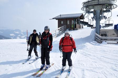 kaprun: KAPRUN, AUSTRIA - MARCH 3, 2012: Skiers enjoying one of the last ski days of the season, skiing in the Austrian Alps