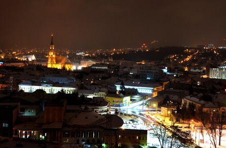 cluj: CLUJ NAPOCA, ROMANIA - JANUARY 17, 2016: The old city of Cluj by night. The town is a major tourist destination as the capital of Transylvania