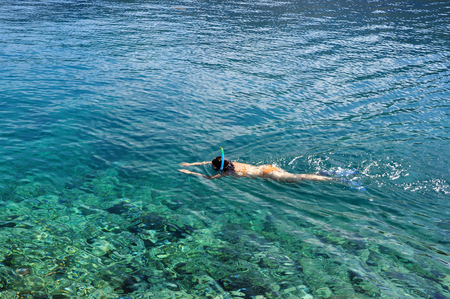 clear waters: Woman snorkeling in crystal clear waters Stock Photo