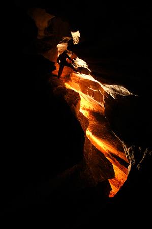 cave exploring: Spelunker exploring a cave