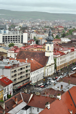 napoca: CLUJ-NAPOCA, ROMANIA - MAY 1, 2011: The medieval city of Cluj Napoca is home of music festivals and sport events and is visited every year by crowd of tourists Editorial