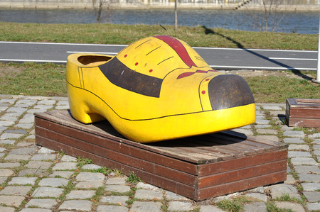 klompen: Traditional yellow Dutch wooden shoe on the street