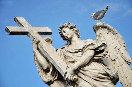 animal angelic: Angel with the Cross. Statue on the Ponte Sant Angelo bridge, Rome